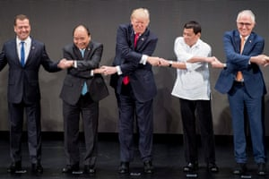(L-R) Russian Prime Minister Dmitri Medvedev, Vietnam's Prime Minister Nguyen Xuan Phuc, US President Donald Trump, Philippine President Rodrigo Duterte and Australia Prime Minister Malcolm Turnbull join hands for a family photo during the opening ceremony of the 31st Association of South East Asian Nations (ASEAN) Summit in Manila on November 13, 2017.