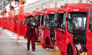 A production line of red vans in China