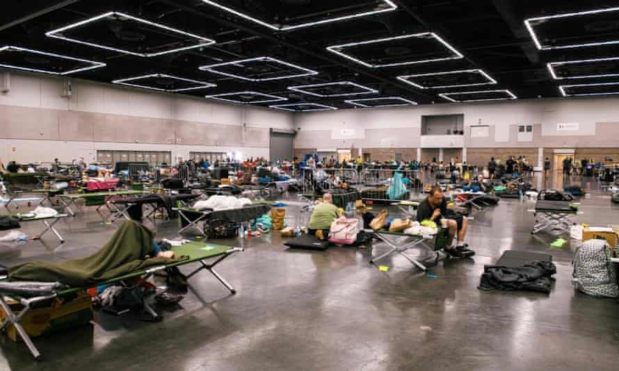 People rest at the Oregon Convention Center cooling station in Portland.