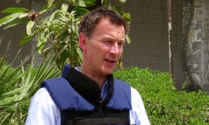 British Foreign Secretary, Jeremy Hunt, talks to reporters upon his arrival at Aden airport in Yemen