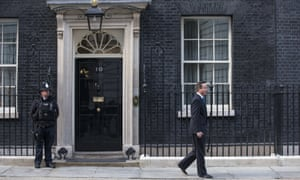 David Cameron walking outside 10 Downing Street