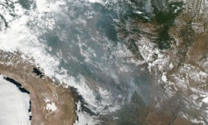 Nasa image from 20 August showing smoke and fires in several Brazilian states including Amazonas, Mato Grosso and Rondonia.