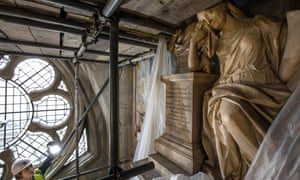 A statue is covered during restoration work at Westminster Abbey.