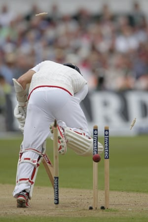 Mark Wood of England is bowled by Mitchell Starc of Australia