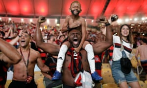 Flamengo fans watching the match on a giant screen at the Macarena Stadium, in Rio de Janeiro, celebrate after Gabriel Barbosa scores.