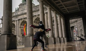 A boxing coach, works out with his student on the arcade of the Royal Military museum at Cinquantenaire park in Brussels