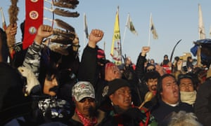 "Native American ""water protectors"" celebrate that the Army Corps of Engineers has denied an easement for the $3.8 billion Dakota Access Pipeline, inside of the Oceti Sakowin camp, near Cannon Ball, North Dakota, U.S., December 4, 2016."