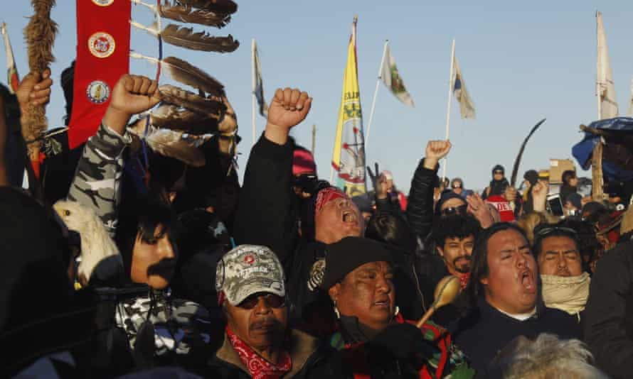 """Native American """"water protectors"""" celebrate that the Army Corps of Engineers has denied an easement for the $3.8 billion Dakota Access Pipeline, inside of the Oceti Sakowin camp, near Cannon Ball, North Dakota, U.S., December 4, 2016."""