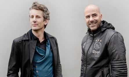 Edwin van der Sar, once a goalkeeper and now the CEO of Ajax, and the club's manager, Peter Bosz.