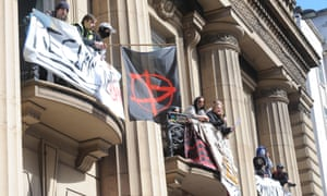 Love Activisits gather to read out their demands as part of their occupation of the old bank building in Liverpool.