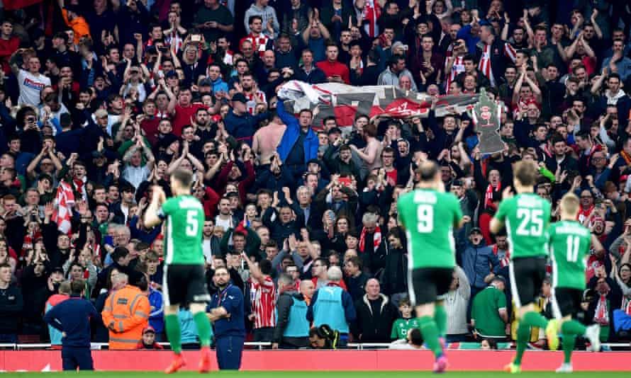Lincoln City fans applaud their team after their FA Cup quarter-final defeat to Arsenal in 2017.