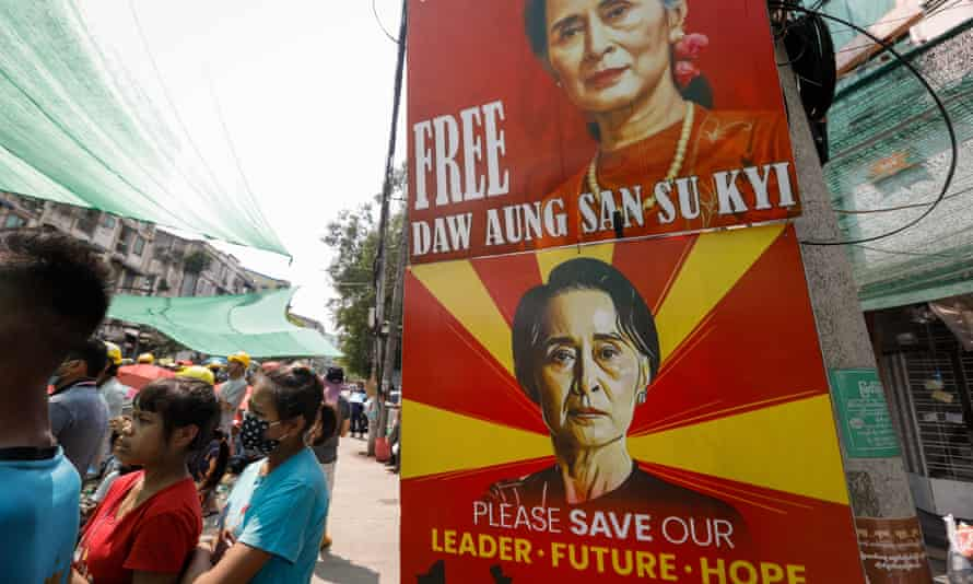 Images of ousted leader Aung San Suu Kyi are displayed during a protest against the military coup in Yangon, Myanmar, on 18 March.