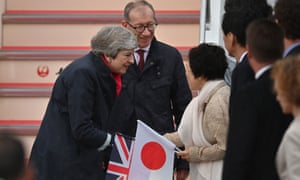 Theresa May and her husband Philip May when they arrived at Kansai airport in Izumisano city, Osaka, this morning ahead of the G20 summit.