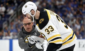 Zdeno Chara (33) is helped off the ice after getting hit in the face with the puck during the second period