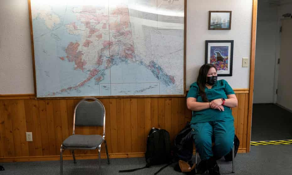 Health aide Daphne Williams waits for a flight to Eagle, Alaska, while transporting a Moderna coronavirus vaccine, in Fairbanks in March. Alaska initially had one of the country's best vaccination rates but early promise has stalled.