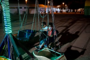 Children play at a park at the Damascus international fair. It is the second year that the event has been held after a five-year hiatus owing to the war
