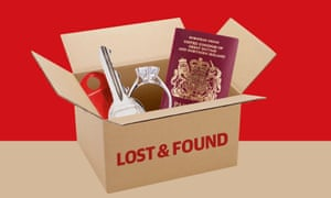 'Lost and found' box containing key, ring, passport