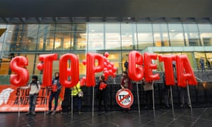 Friends of the Earth protest against CETA and TTIP in front of the European council building in Luxembourg.