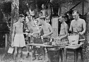 Bill Norways, centre, serves food at a Japanese POW camp in Kranji, Singapore.