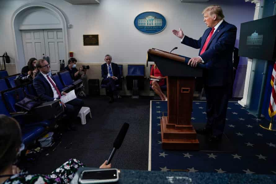 Trump at the press briefing on Thursday.