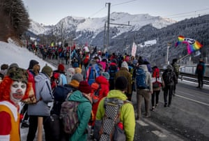 Hundreds of climate protesters who are on a there-day protest march from Landquart to Davos pass the city of Klosters, Switzerland, Monday 20 January, 2020