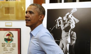 Barack Obama gets a tour of the Bob Marley museum in Kingston, Jamaica.