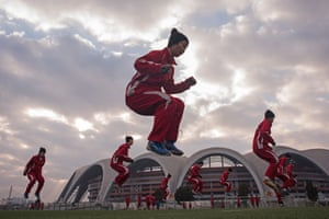 Female students of the Pyongyang International Football Academy take part in a training and aerobics session