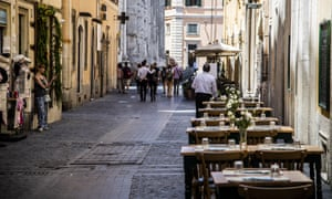 A restaurant lies empty at lunchtime in Rome