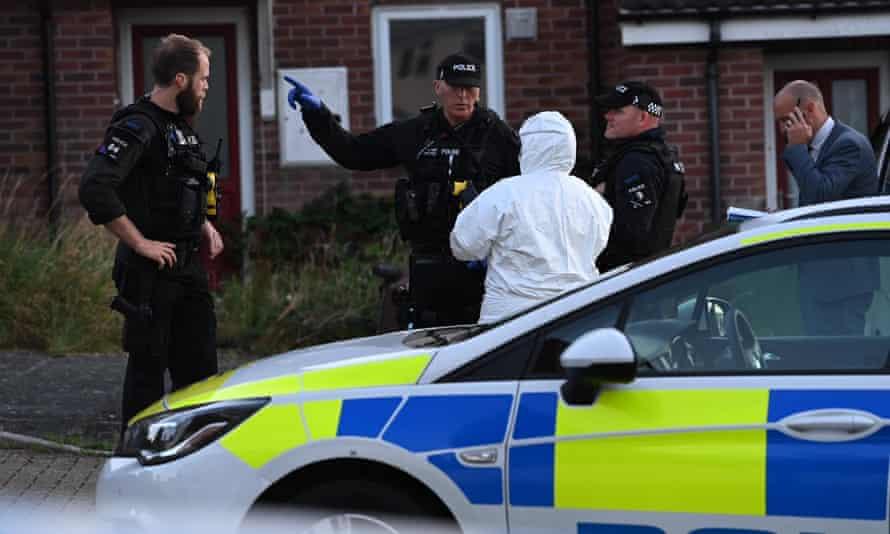 Police talking at the scene