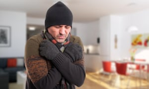 Portrait of sick man shivering from cold inside the house