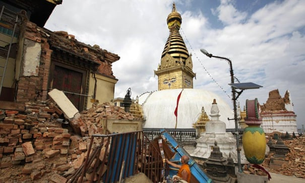 A Buddhist monk salvages religious items from a monastery around the famous Swayambhunath stupa after it was damaged by Saturday's earthquake.