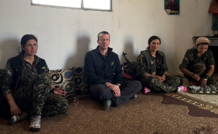 Carne Ross with members of the women's militia in Rojava, Syria. The film is dedicated to Vijan, second right, who was killed fighting Isis a few months after this photo was taken