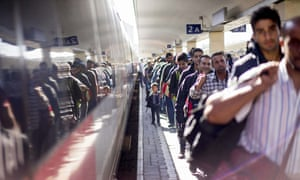 Refugees at Vienna's Westbahnhof train station, after arriving by train from Hungary