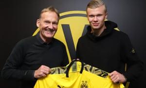Erling Braut Haaland, right, Borussia Dortmund CEO Hans-Joachim Watzke after agreeing his move to the Bundesliga.