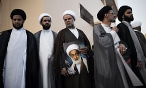 Bahraini Shiite clerics attend a protest against the revocation of the citizenship of top Bahraini Shiite cleric Sheikh Isa Qassim (portrait), on June 20, 2016 near Qassim's house in the village of Diraz, west of Manama. Bahrain said it has revoked the citizenship of the Sunni-ruled kingdom's top Shiite cleric, accusing him of sowing sectarian divisions, in a move that sparked protests among the majority community. / AFP PHOTO / MOHAMMED AL-SHAIKHMOHAMMED AL-SHAIKH/AFP/Getty Images