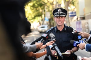 A police press conference is held at Flinders Street