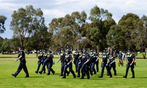 Large numbers of police are seen at the Elsternwick Park in Melbourne over the weekend as protesters rally against the lockdowns restrictions.