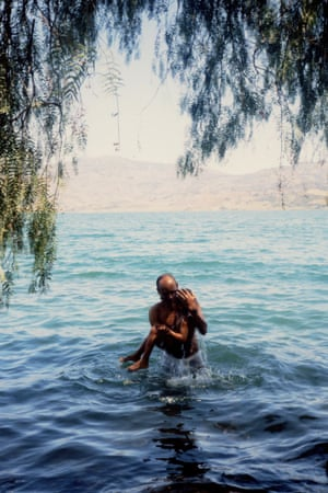My father, carrying me out of the water. (Ethiopia)