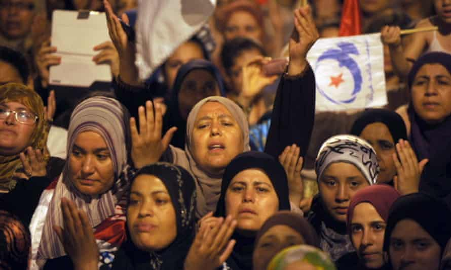 Ennahdha supporters protest in solidarity with Tunisia's Islamist government.