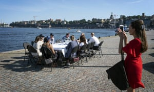 A socially distanced after-work drink in Stockholm. Sweden is considering local lockdowns.