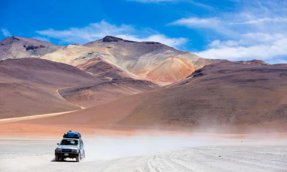 Jeep driving through the Atacama desert, Chile.
