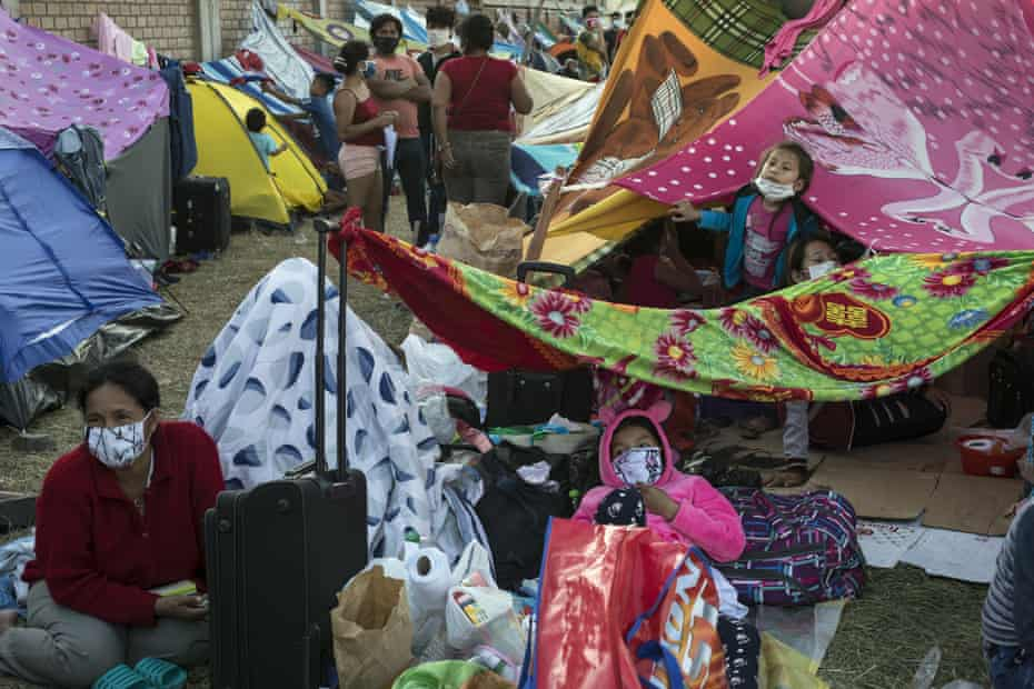 Migrants from Iquitos gather in a makeshift camp in Lima, Peru.