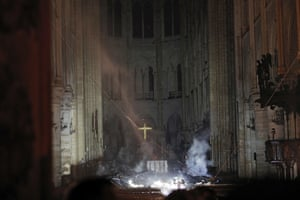 Smoke is seen in the interior of Notre Dame cathedral in Paris