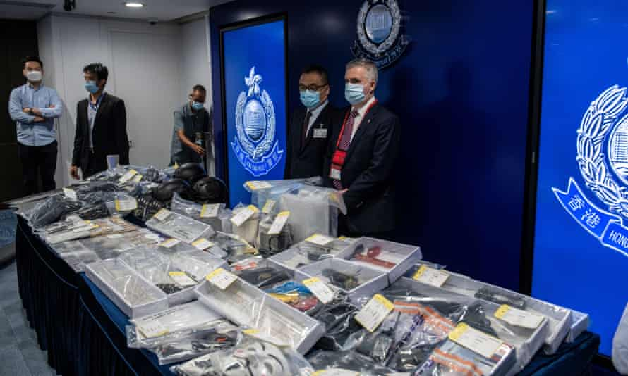 Police present evidence at a press conference in Hong Kong after the arrest of nine people over an alleged bomb plot