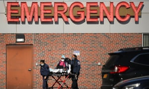 Medical workers tend to a patient at a Brooklyn hospital that has seen a rise in coronavirus-related cases on Tuesday in New York City.