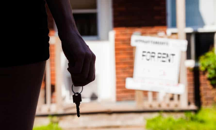 Young Woman standing with keys in front of her new apartment<br>