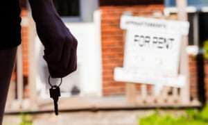 Person standing with keys in front of a rented apartment