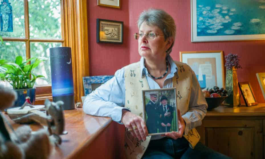 Liz Thomson with a photo of her late father.