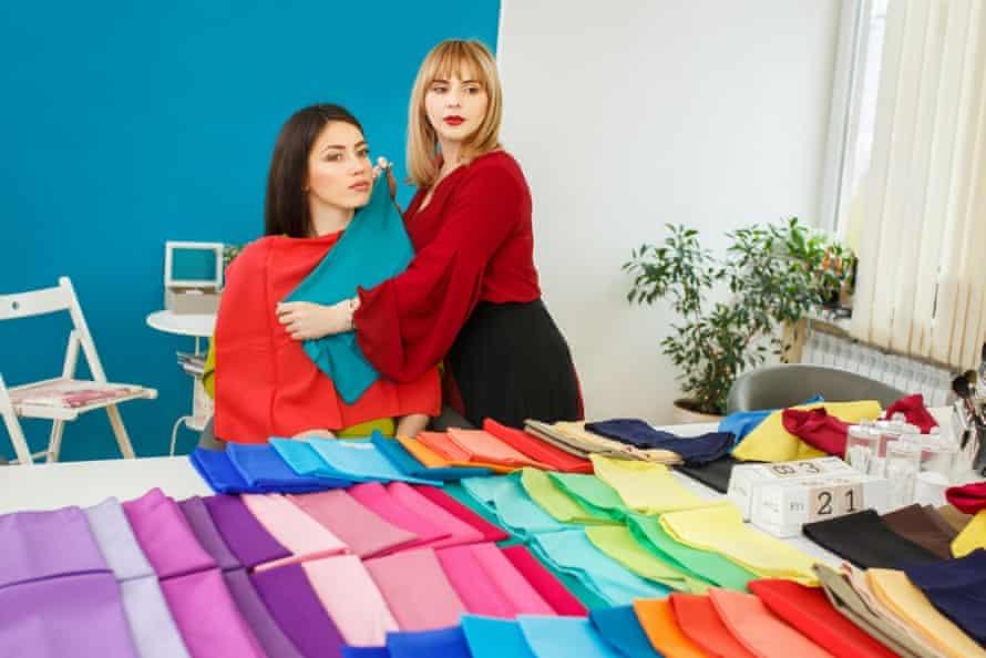 A stylist doing a seasonal colour analysis for a client