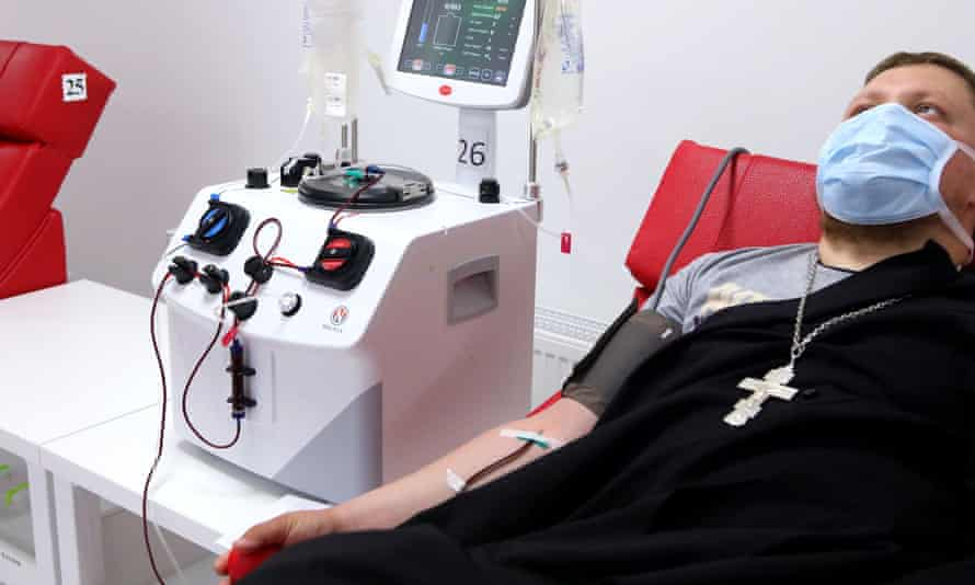 A Ukrainian priest who has recovered from Covid-19 donates blood plasma in Kharkiv
